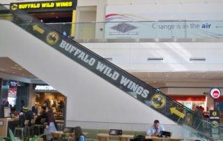 buffalo-wild-wings-escalator-perforated-window-film-window-advertising