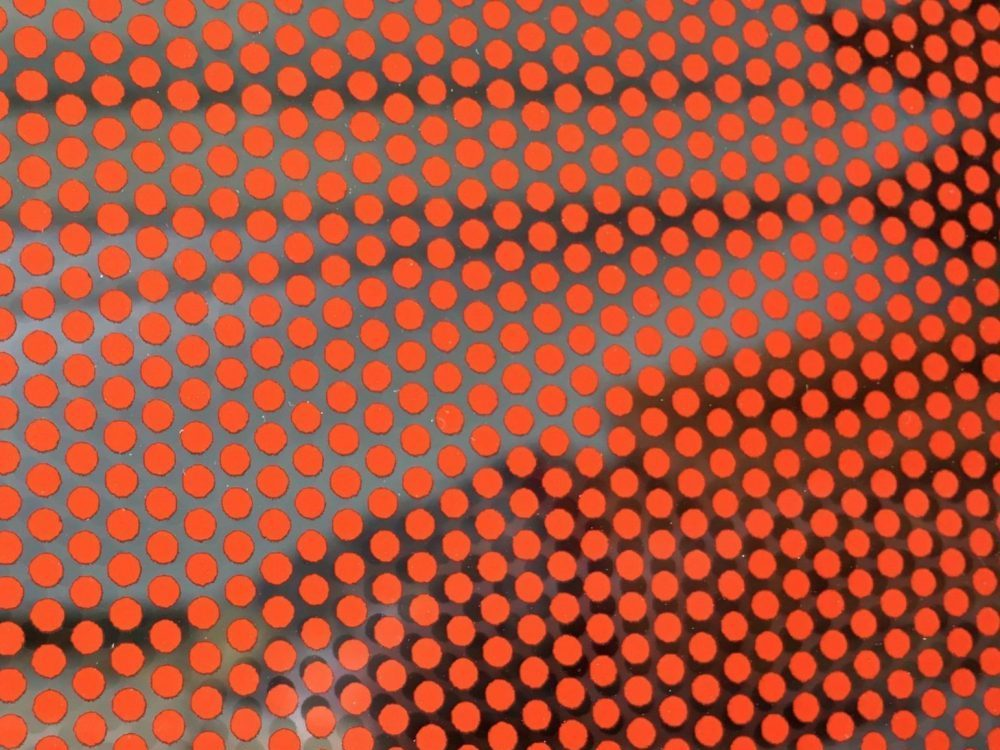Contra vision red fritted dots on glass