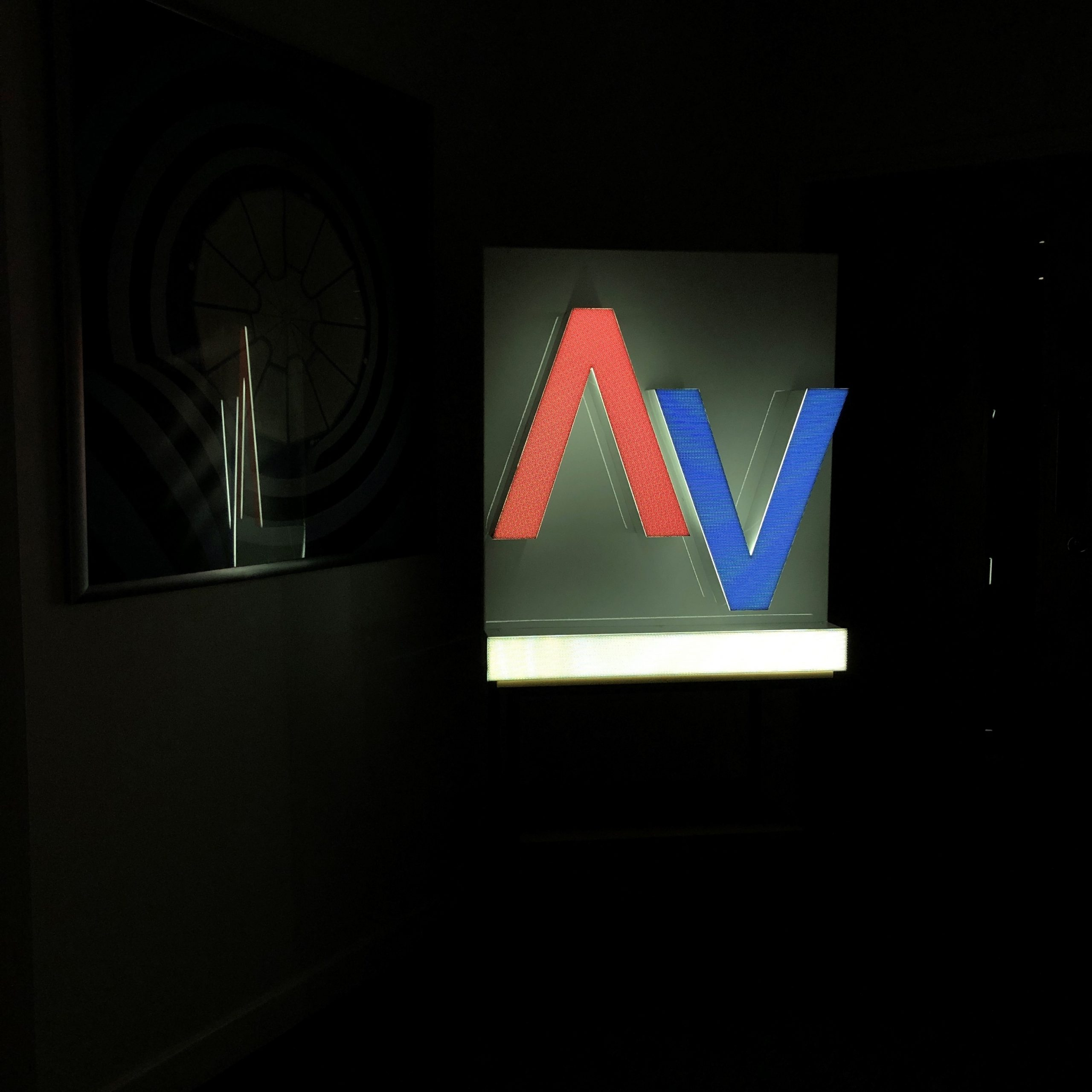 Black Perforated Dual Color Signage Channel Letter Nighttime